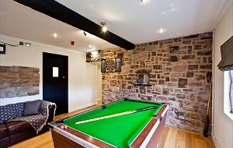 Games room with pool table and dart board.