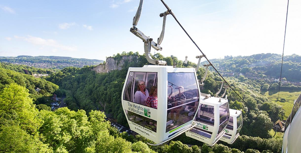 An image of a family in a cable car above the Derwent Valley