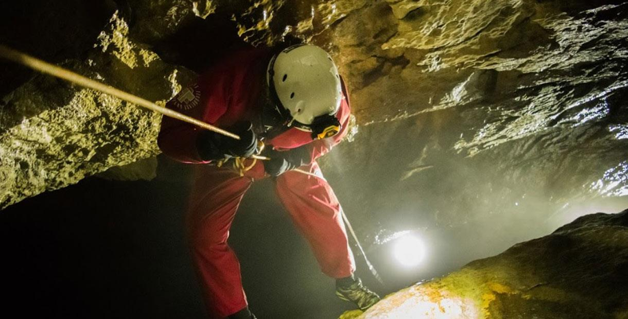 Abseiling down a cave in Castleton, Hope Valley
